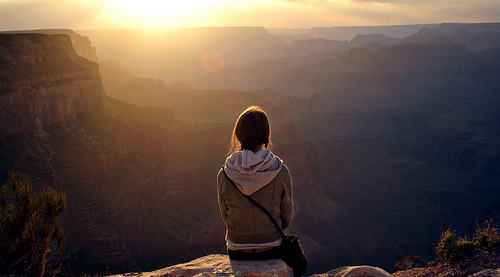 Girl Sitting Alone on Cliff