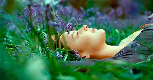 Girl in Purple Lilac Flowers in Meadow