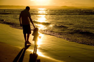 Father and Daughter playing at the beach